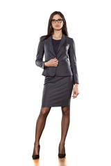 pretty business woman standing on white background