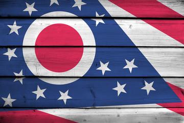 Ohio State Flag on wood background