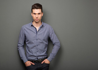 Handsome young man in smart shirt staring