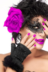 Beauty Fashion Woman in Carnival Mask. Purple Lips and Manicure