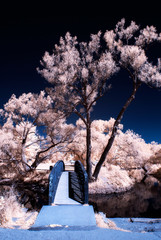 Infrared Bridge Over Water in a Park