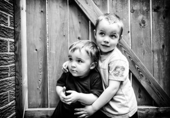 Two Boys Together Looking Up - Black and White