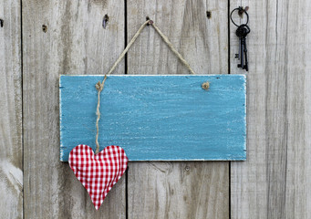 Blank blue sign with red heart and iron keys