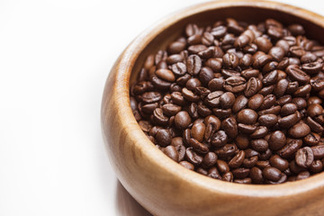 Heap of Roasted Aromatic Coffee Beans Placed in Wooden Bowl over