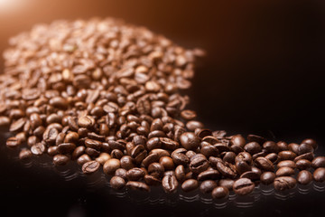 Line made of Roasted Coffee Beans Over Black Background. Light E