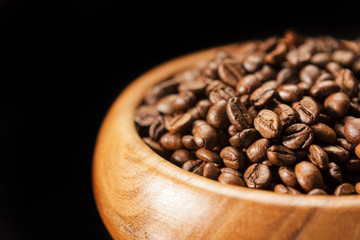 Closeup Fragment of Wooden Bowl with Heap of Coffee Beans. Over