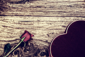Rose and Heart Shaped Box on Rustic Wood