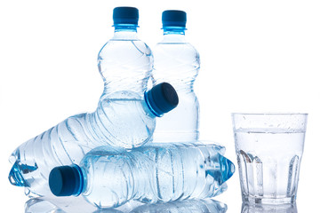 Glass and bottles with fresh water