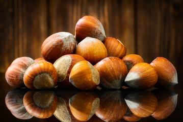 Raw Organic Whole Hazelnuts on wooden background. Selective