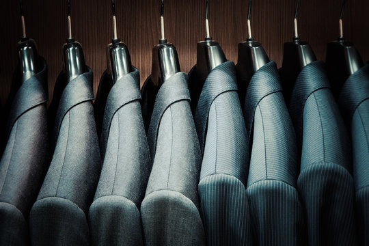 Row of men suit jackets on hangers