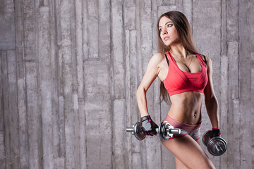 bodybuilder girl with dumbbell