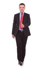 Happy business man walking on white studio background