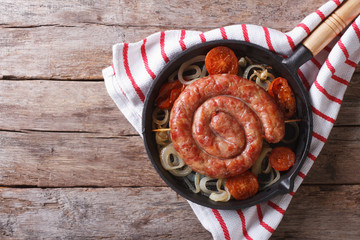 Grilled sausage in a pan. horizontal top view
