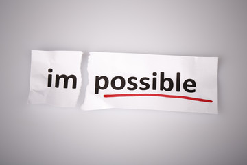 The word impossible changed to possible on torn paper