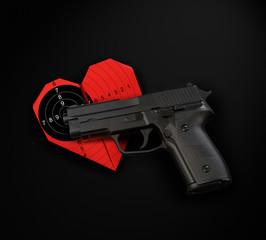 black gun red heart target