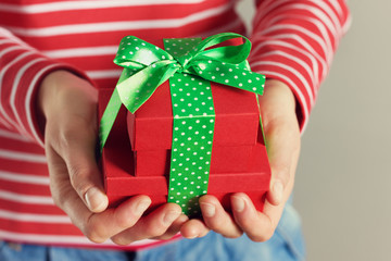 woman hands holding a gift or present box.