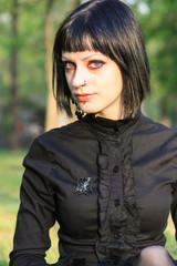 Beauty goth girl walks in park