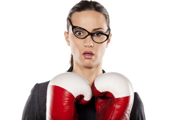 young woman with boxing gloves with a surprised look