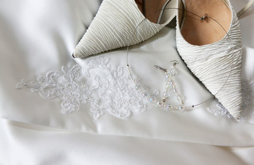 Elegant bridal shoes and jewelryon wedding dress