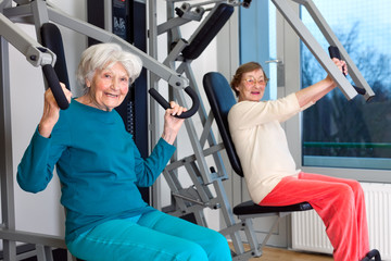 Happy Elderly Women Working Out at the Gym.