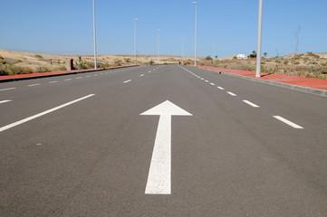 arrow on a asphalt street to the future