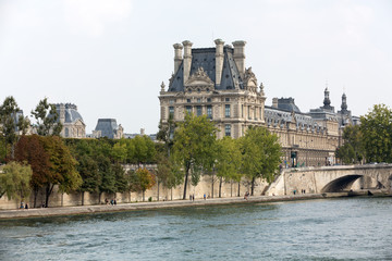 The Louvre and  the Seine River in Paris .