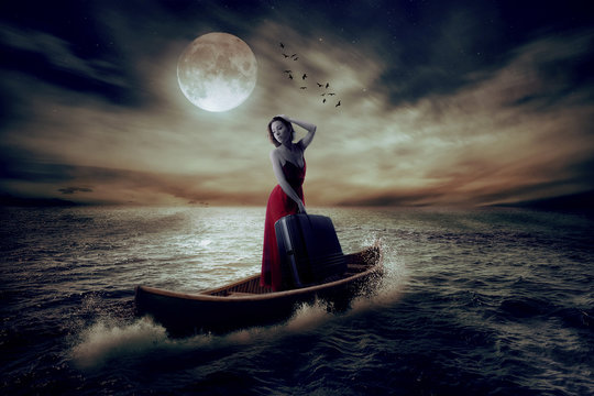 stylish woman with suitcase standing on boat middle of ocean