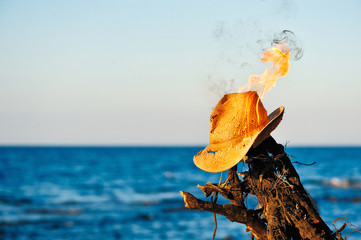 Burning wicker hat