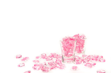 pink hearts glass  on white background