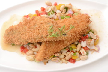 Fried fish with herb salad