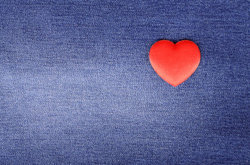 Heart shape on blue jeans texture