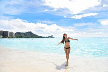 Happy beach woman in bikini on Waikiki Oahu Hawaii