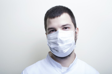 Portrait on a young dentist man