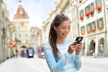 Wall Mural - Woman on smart phone in Bern Switzerland