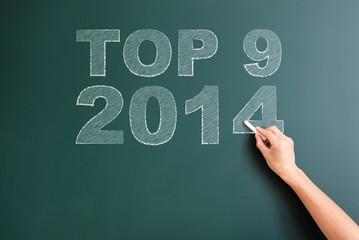top 9 2014 written on blackboard
