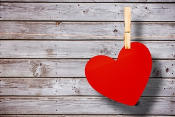 Wall Mural - Composite image of heart hanging on line