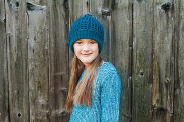 Adorable little girl of 7 years old wearing winter hat