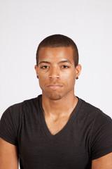 Black man looking thoughtfully at the camera