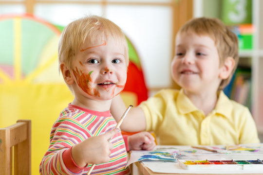 children painting at home or playschool
