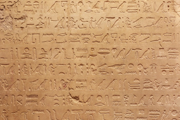 Egyptian hieroglyphs stone background