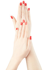 Hands with red nail polish manicure on white, clipping path