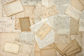 Old letters, handwritings, vintage postcards. Grungy paper textu
