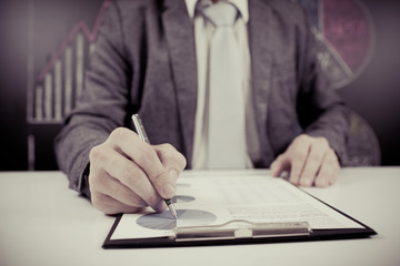 man hand with pen and business report