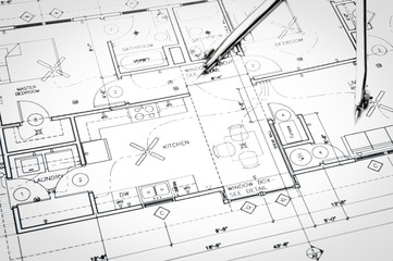 Construction blueprints and drawing instruments on the worktable