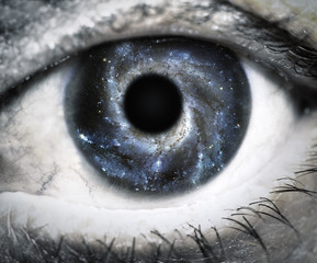 Human eye looking in Universe.