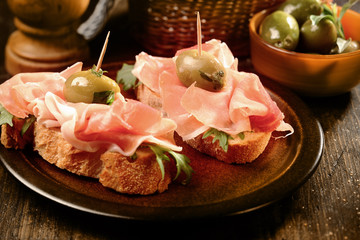 Canapes or tapas with proscuitto ham