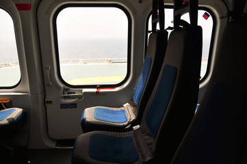 Helicopter interior and seat for passenger