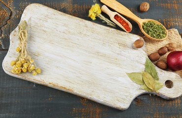 Keuken foto achterwand Koken Different spices and herbs with cutting board