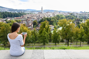 Tourist with smart phone camera in Bern