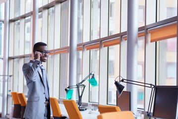 African American businessman talk by phone